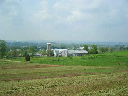 landscape shot of lancaster, PA with rolling hills and amish farms
