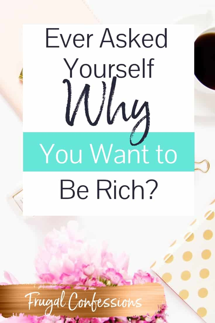 """white desktop with pink flowers, gold stapler with text overlay """"ever asked yourself why you want to be rich?"""""""