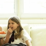 mother and daughter eating veggies together