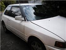 1990 mazda familia beater car