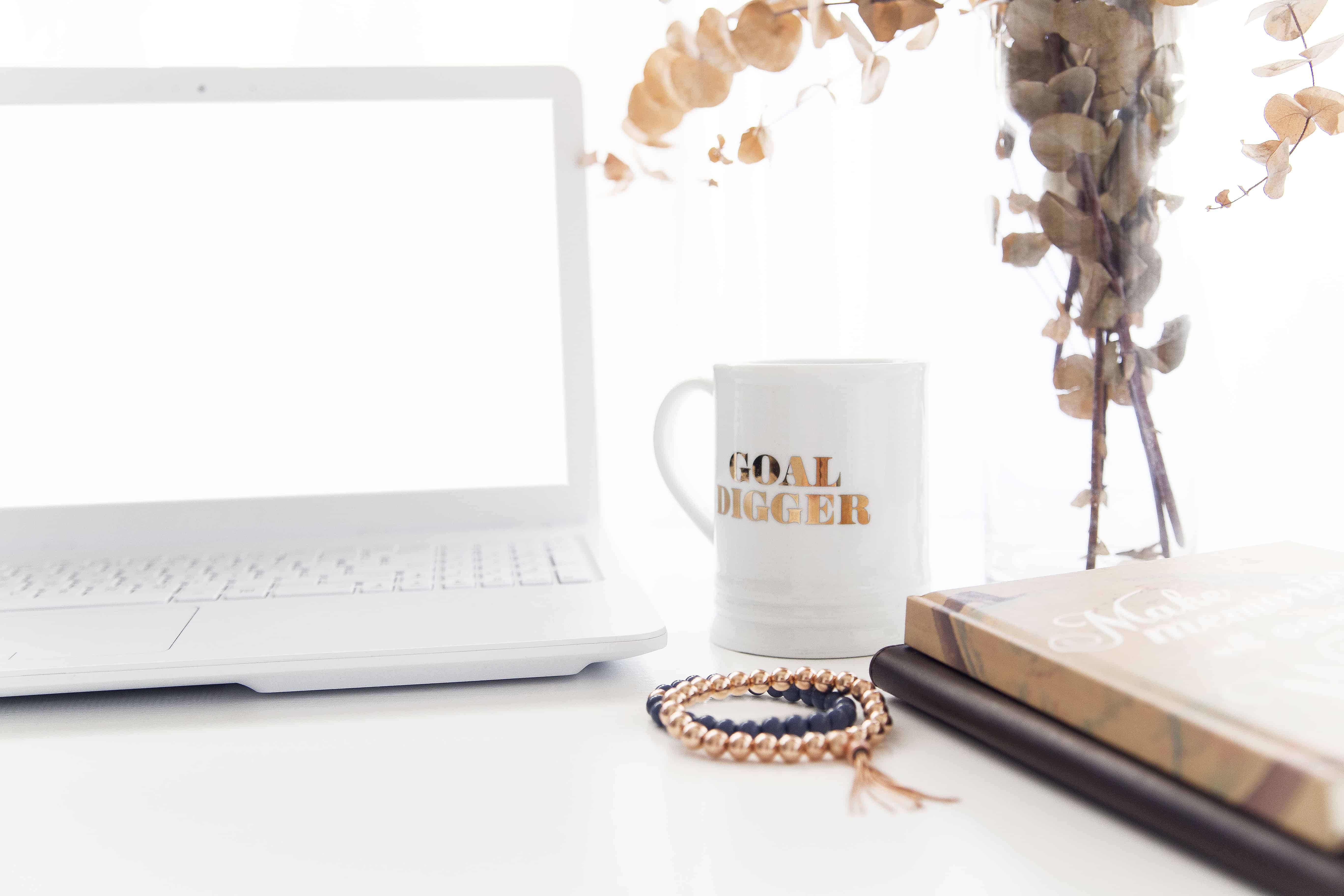 white desktop with goal-digger, coffee mug for weight loss competition inspiration