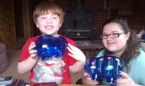 niece and nephew with piggy banks