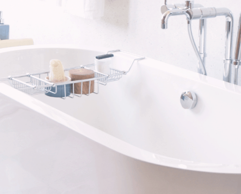white bathtub with overlay holding spa materials