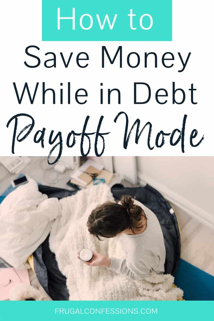 "woman sitting on comfy bed under blanket with coffee with text overlay ""how to save money while in debt payoff mode"""