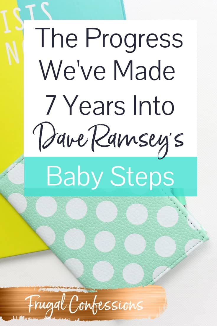 "white desk with yellow/blue notebook with text overlay ""progress we've made 7 years into dave Ramsey's baby steps"""