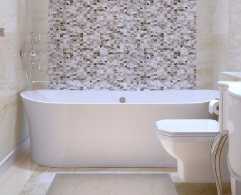 bath tub and european toilet with a mosaic tile background