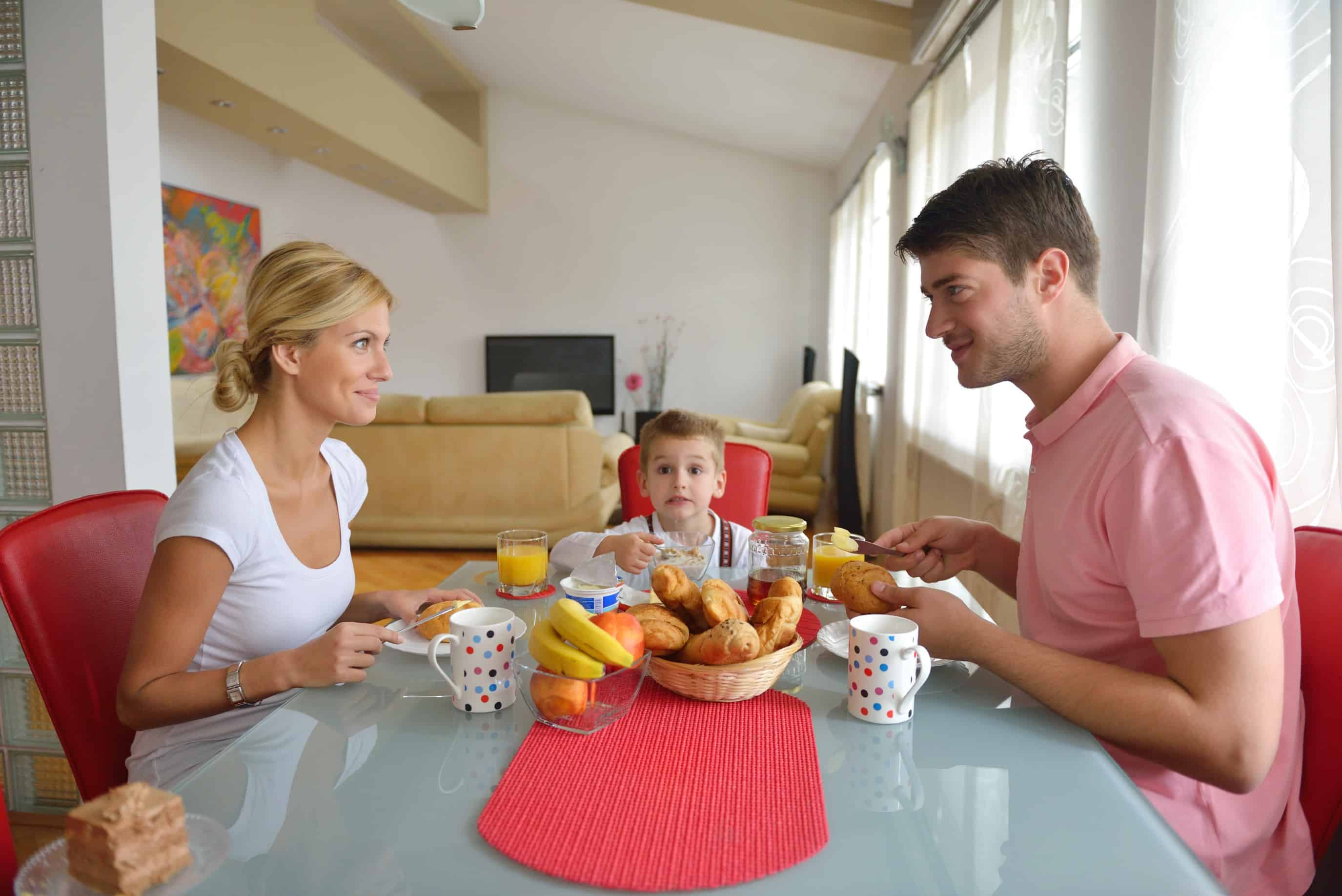 young couple having at home date night with child in between