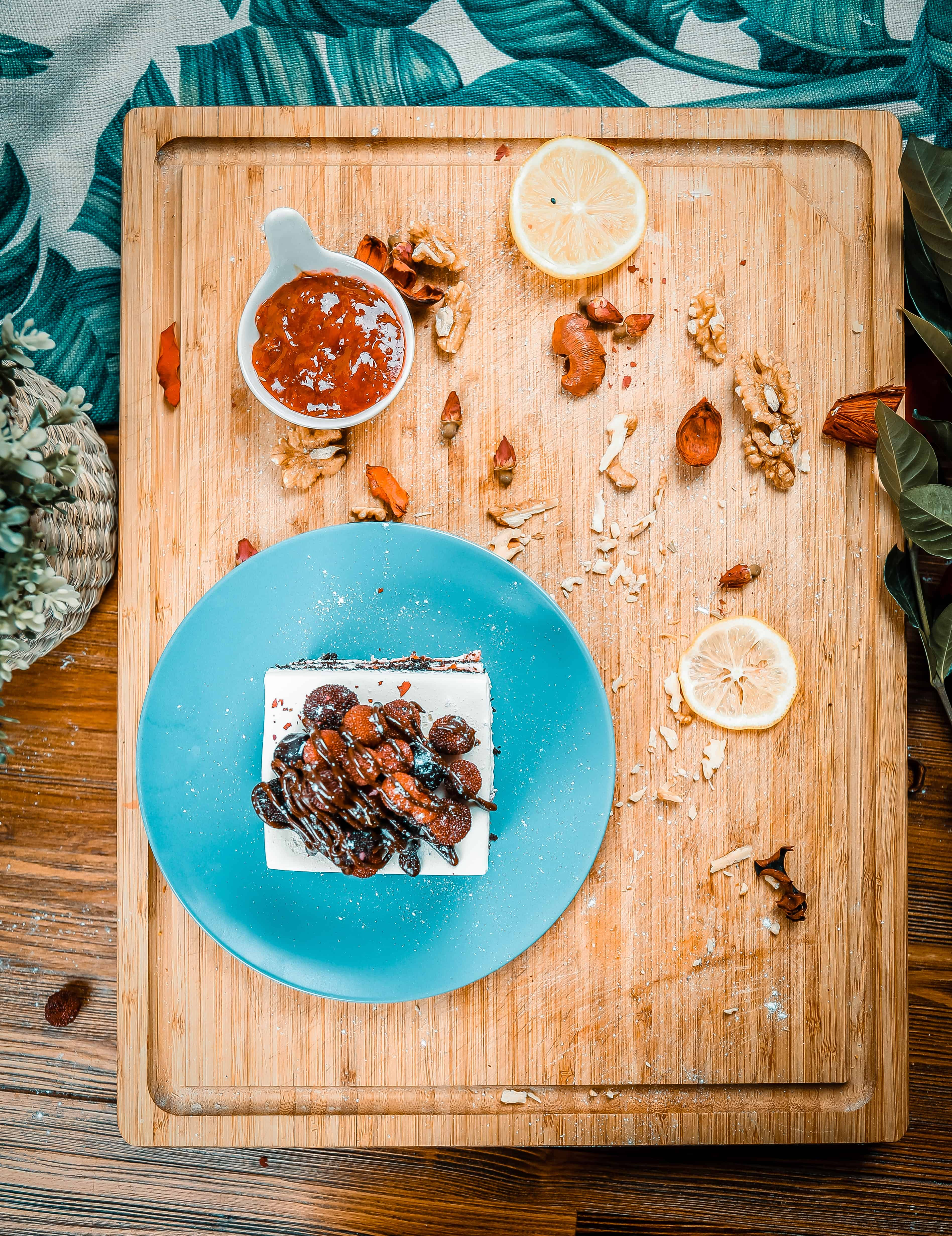 wooden table with turquoise plate and finger foods