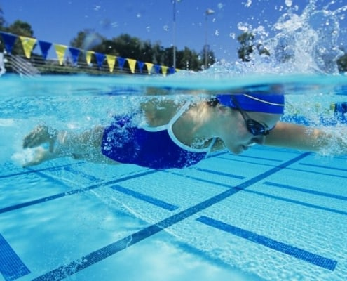woman swimmer athlete in pool, looking for companies wanting to sponsor athletes
