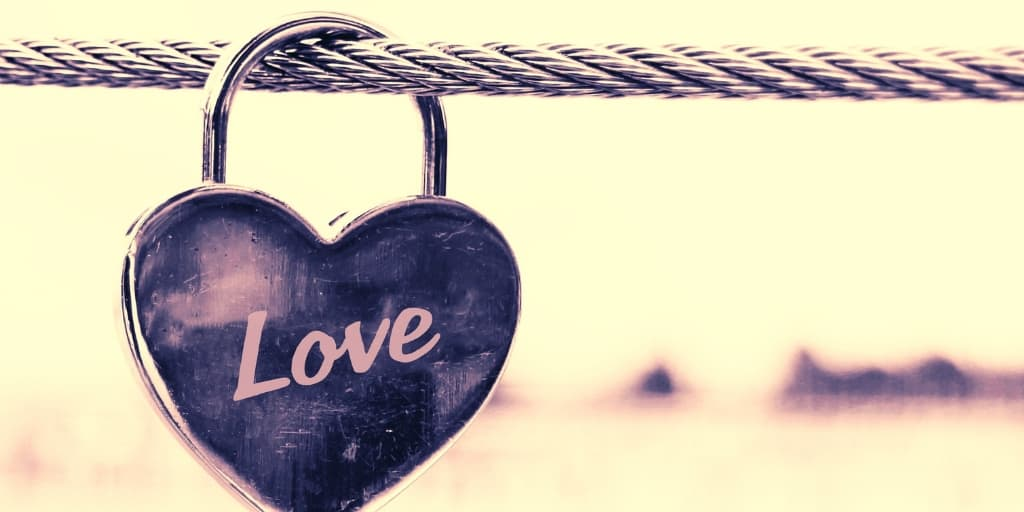 """a rope with a lock that reads """"love"""" on it, a good location for an inexpensive date idea"""
