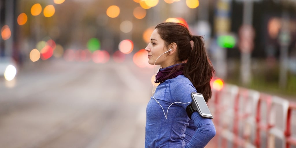 girl with fitbit on shoulder, looking to get paid to walk and run