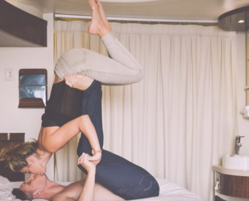 couple at home doing couple yoga move