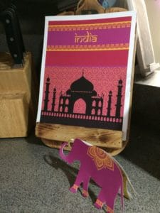 picture of India-themed date night with elephant invitation in front