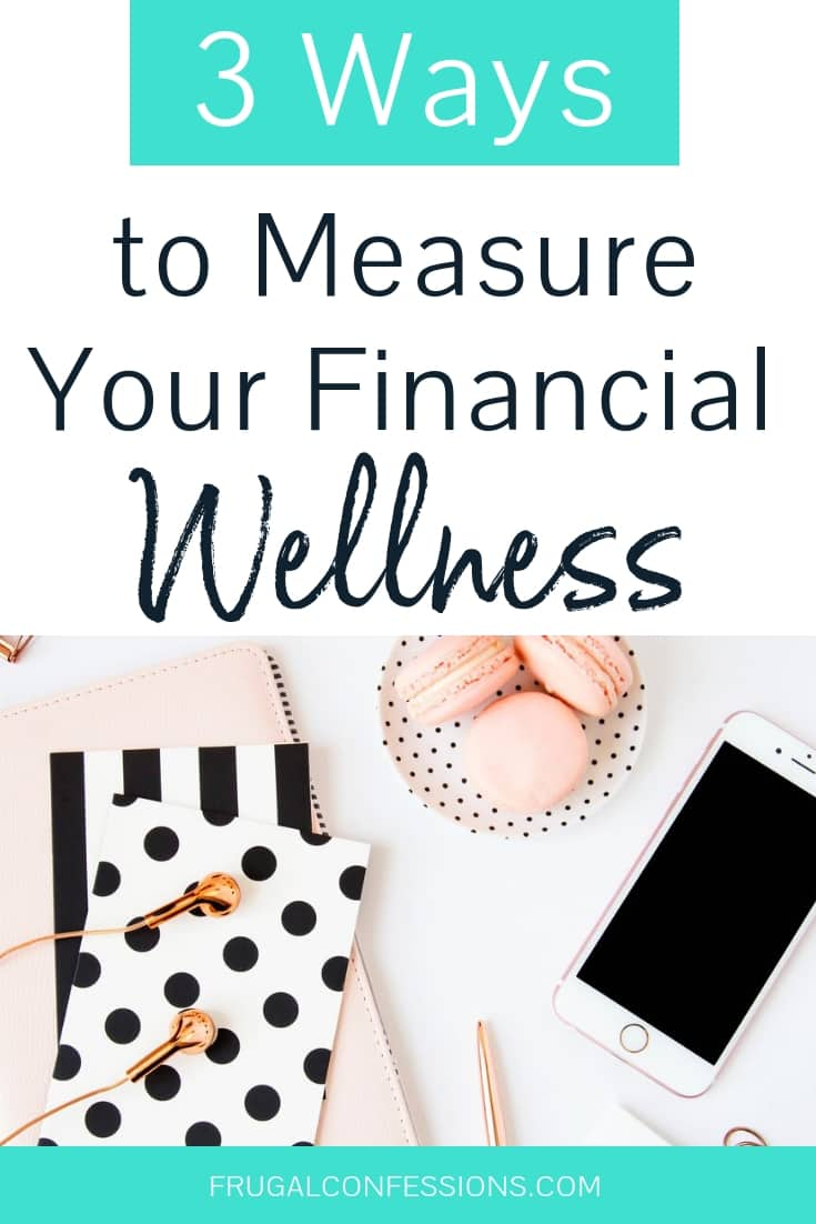 "white desktop with gold earbuds, iPhone, and pink stationary with text overlay ""3 ways to measure your financial wellness"""