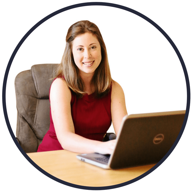 young woman behind computer, at desk, a frugal living personal finance writer