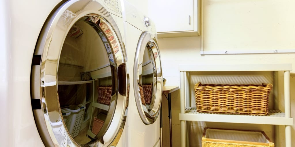 brand new laundry machines in laundry room