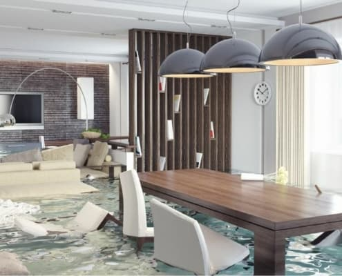 home dining room with flood damage, in flood waters
