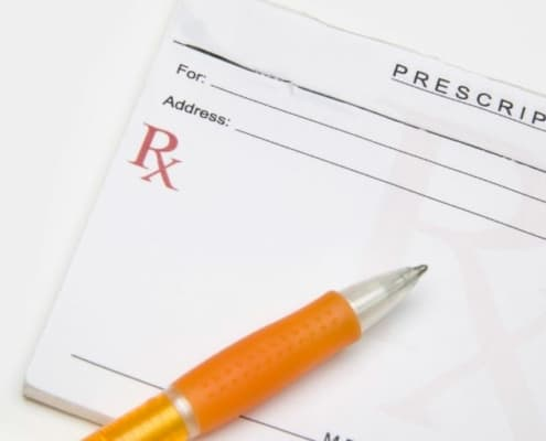 prescription pad with pen, on white background