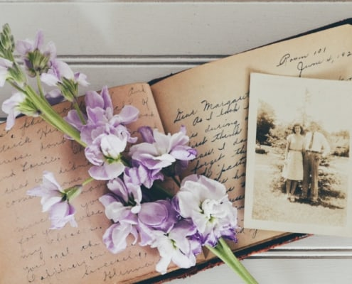 Genealogy Project book with purple flowers on top