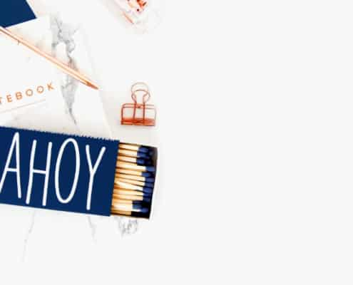 "white desk with matchbox that says ""ahoy"""