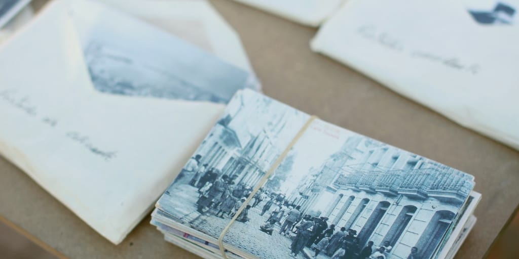 envelopes filled with old photos and genealogy research
