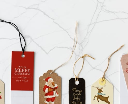 holiday gift tags on a marble desktop background