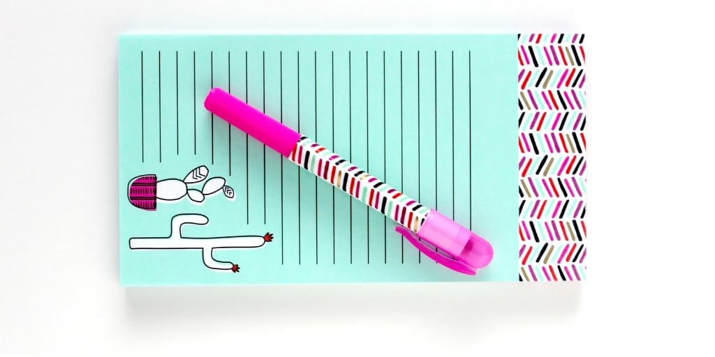 blue grocery list pad with cartoon cactus and pink pen