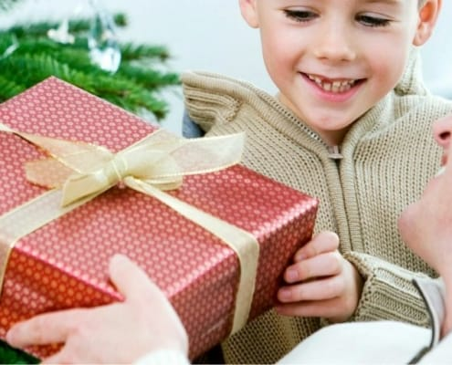 guy accepting a gift from son for Christmas