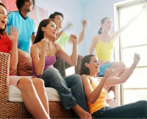 group of friends hanging out together at home without spending money