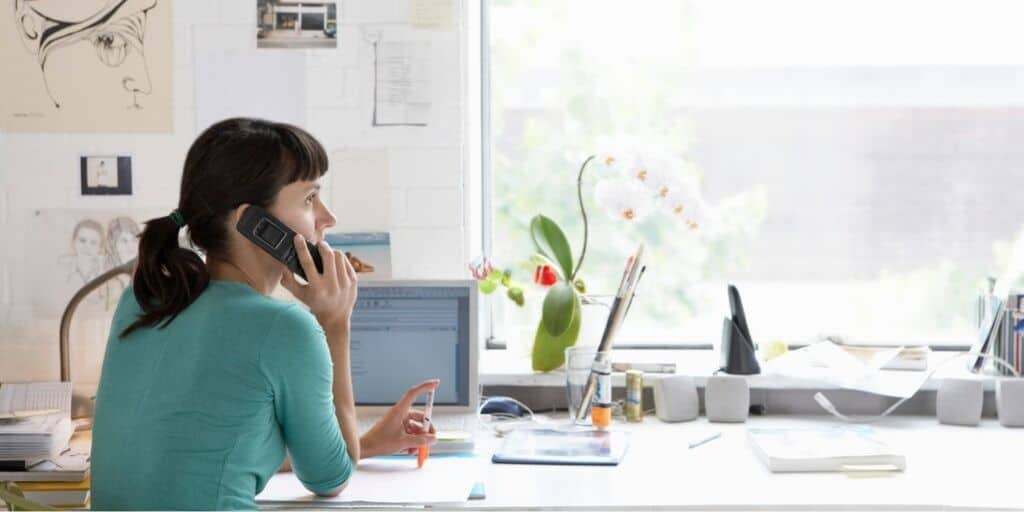 young woman on phone, negotiating after getting her credit sesame score