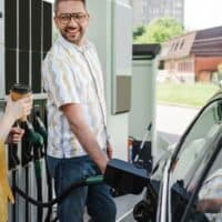 woman and man getting gas at start of things to do in the car for adults