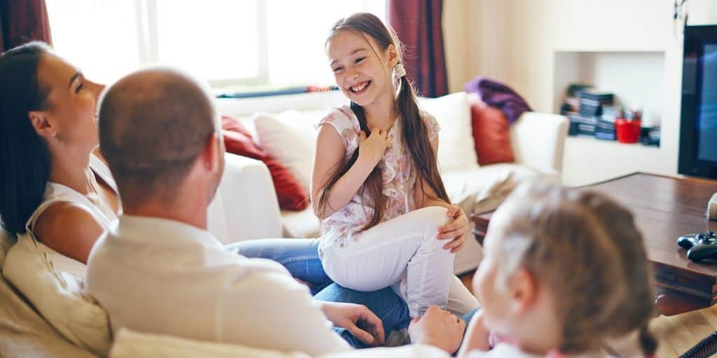family laughing with fun things to do as a family at home