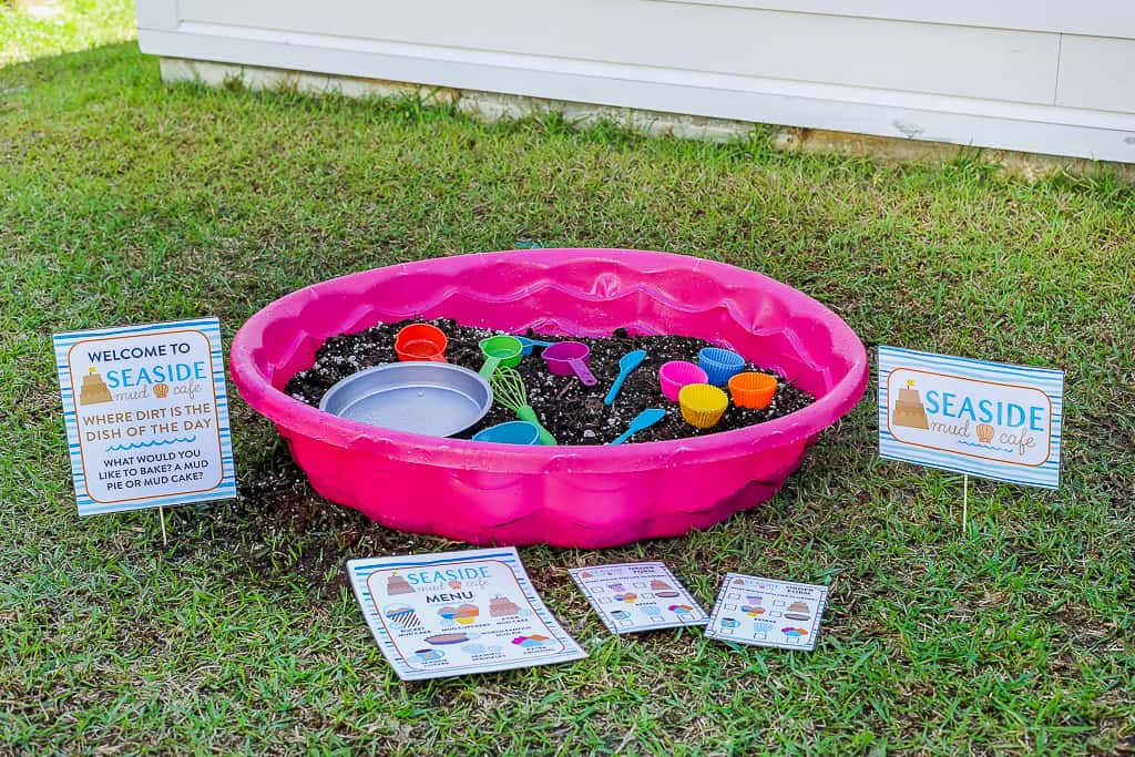 kiddie pool with mud in it, and mud cafe sign, great backyard activity for kids