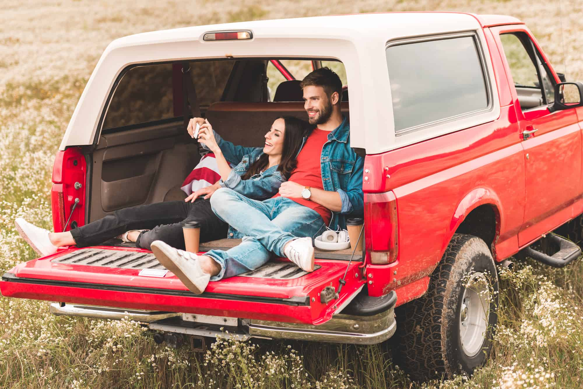 couple in back of truck for, using an outdoor date idea