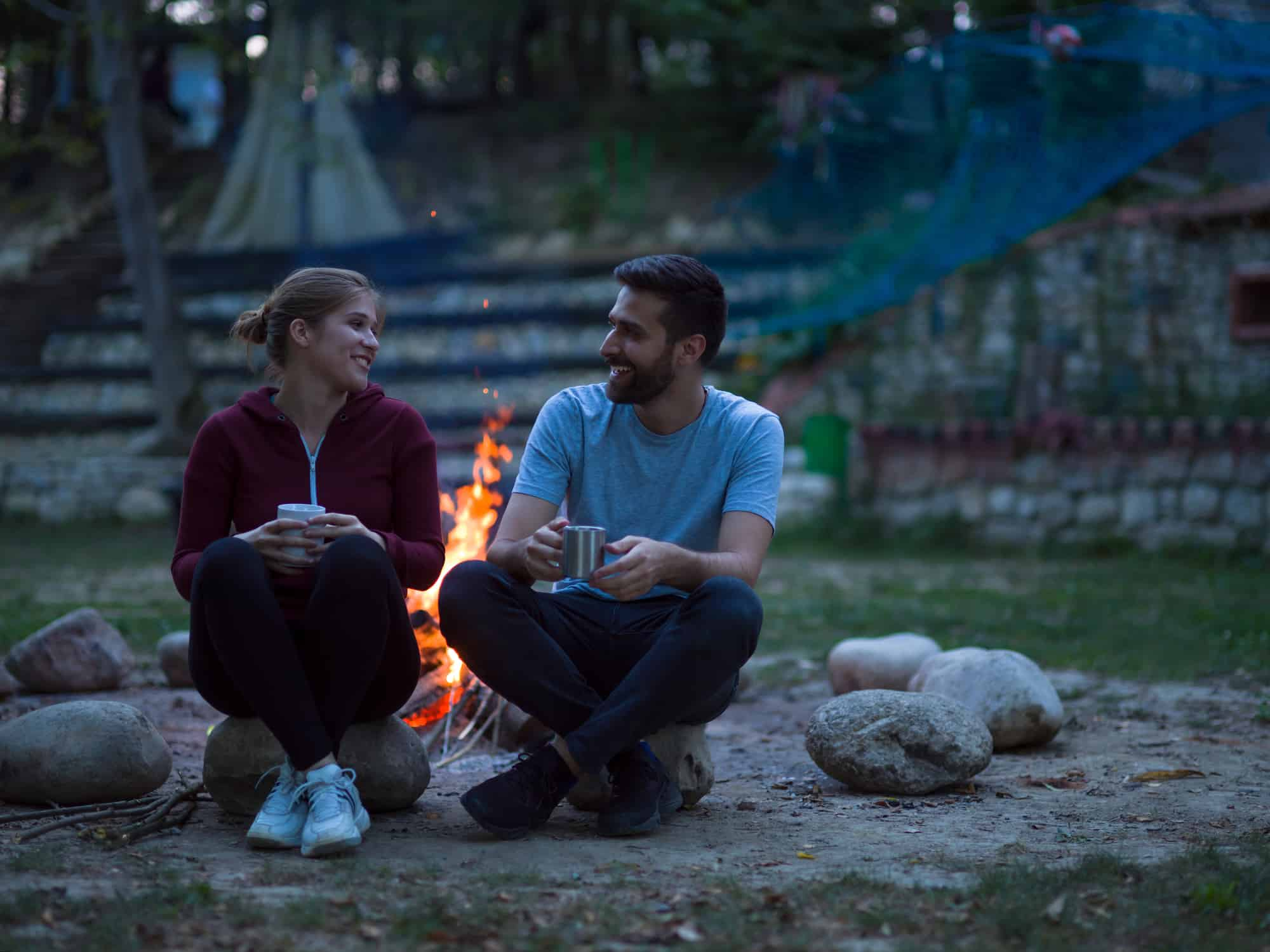 young couple enjoying an outdoor date night at home