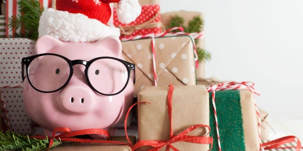 piggybank with santa hat on pile of wrapped gifts, Christmas budget printables