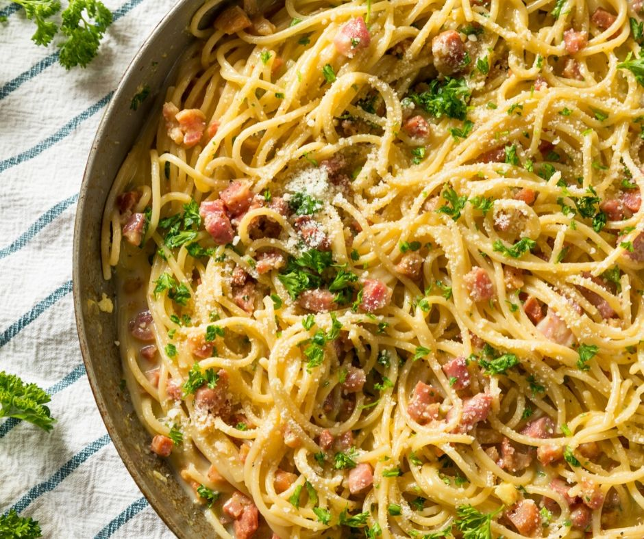 pan of hot carbonara, one of the great inexpensive meals for large groups