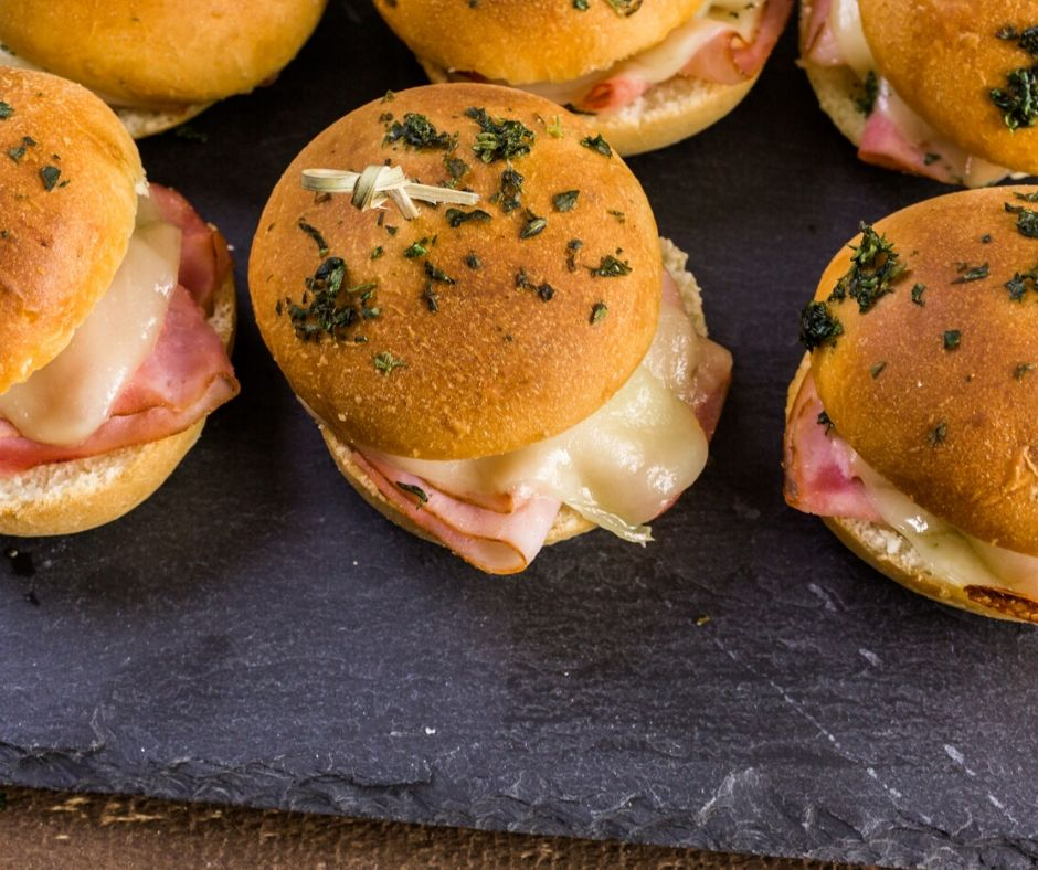 ham and cheese sliders on slate serving platter, great winter meals for a group