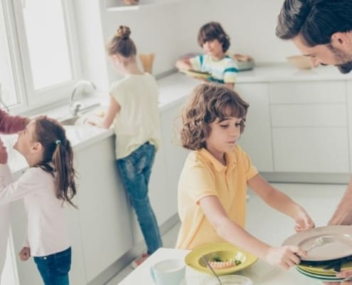 large family in kitchen, kids helping parents cook - large family saving money
