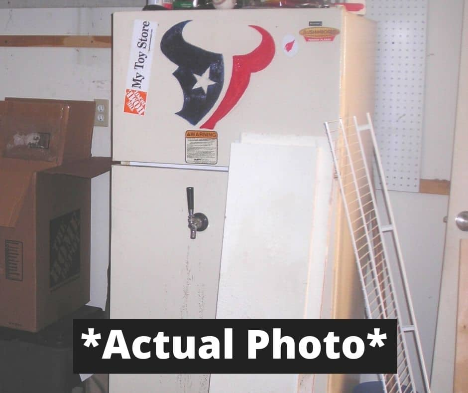 our used refrigerator that we sold with Texans logo painted on front - sell used appliances for cash