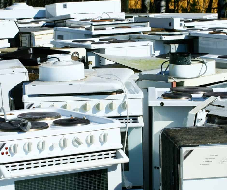 bunch of broken appliances at a junk yard about to be scrapped - who buys broken appliances