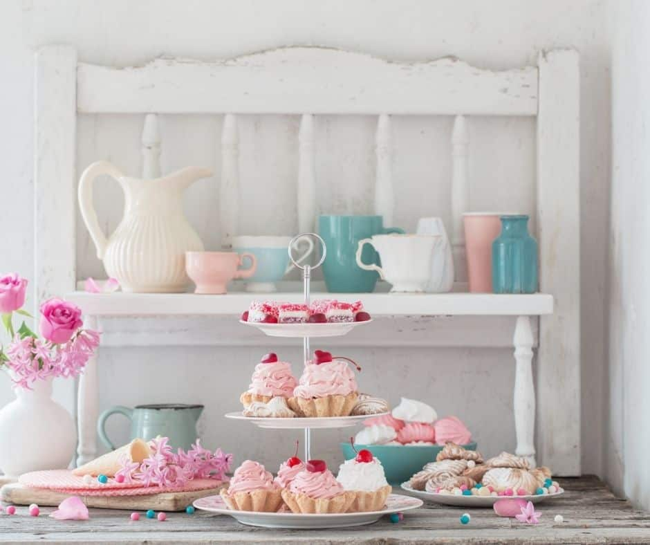 three tier cake and tea cake platter filled with gorgeous pastries on white background