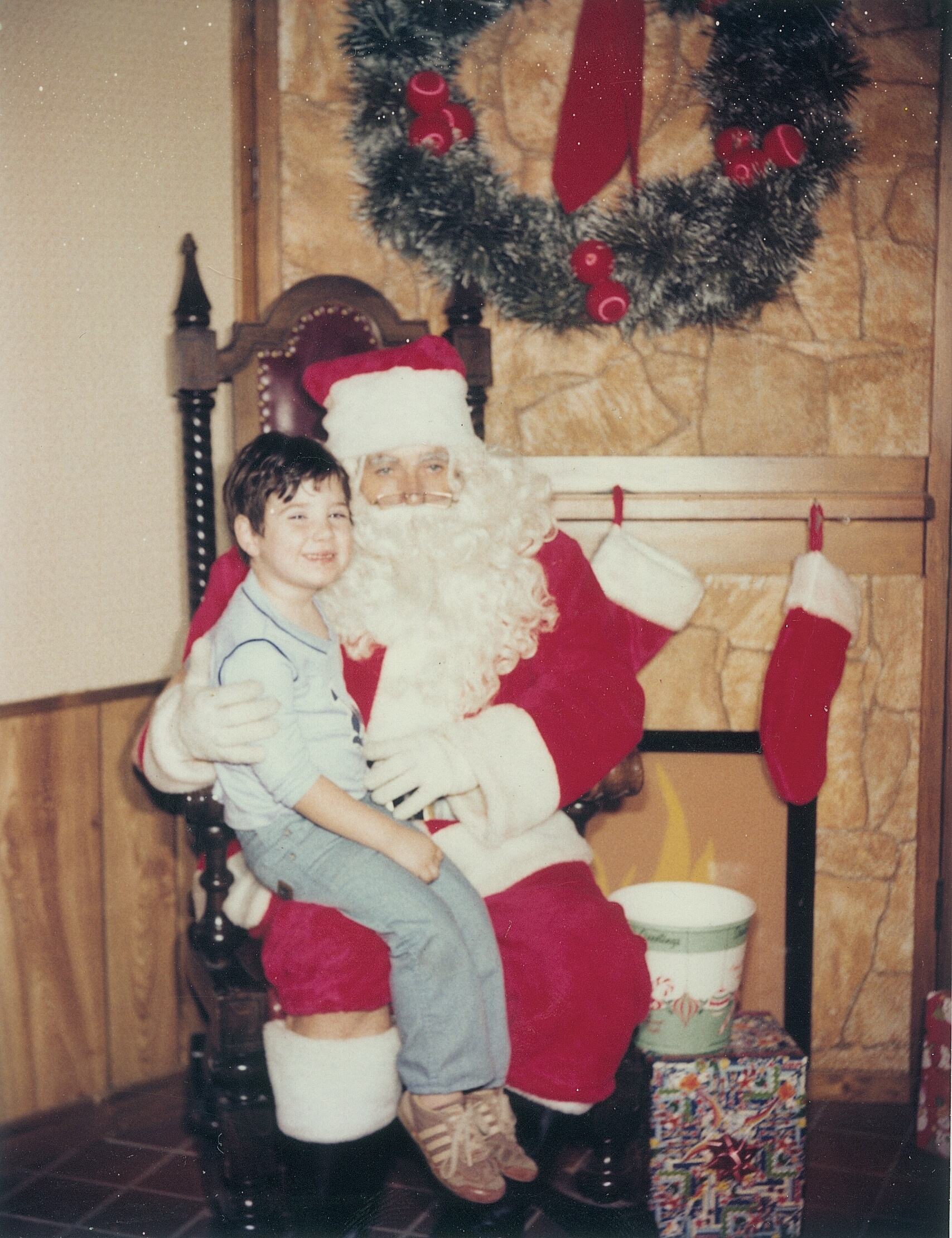 author's husband when he was 6, sitting on Santa's lap